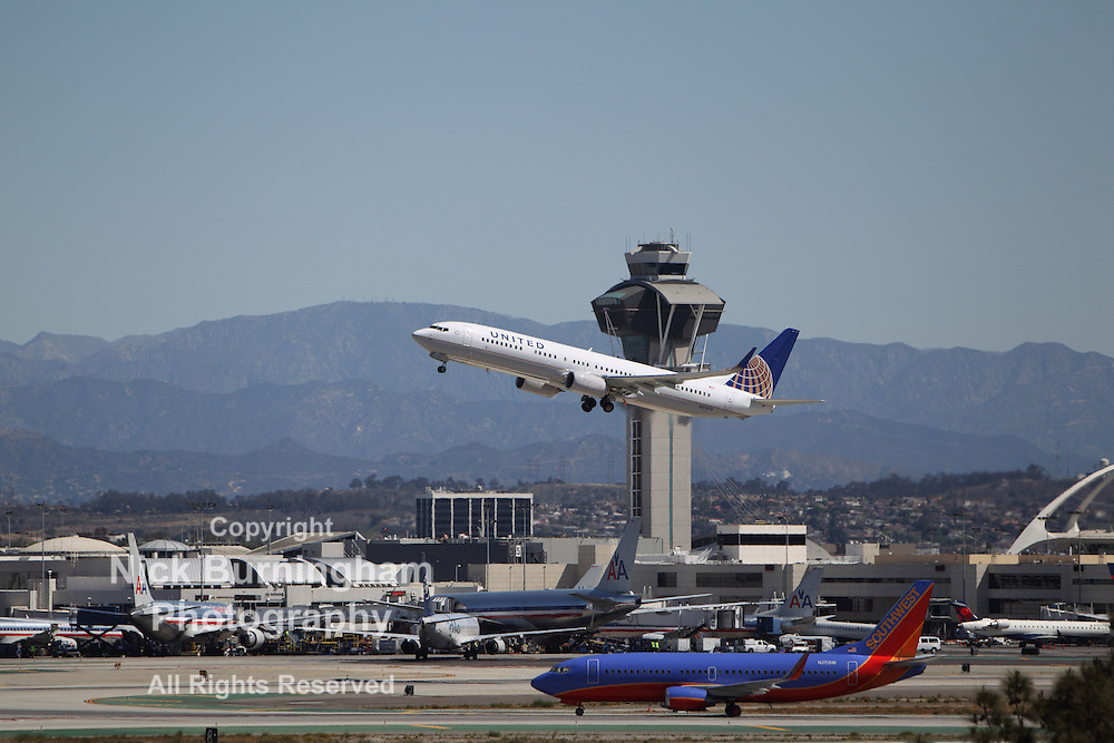 LOS ANGELES, CALIFORNIA, USA - April 17, 2013 - United Airways Boeing 737-924ER takes off from Los Angeles Airport on April 17, 2013. The plane has a range of 6,045 km and a maximum speed of 544 mph