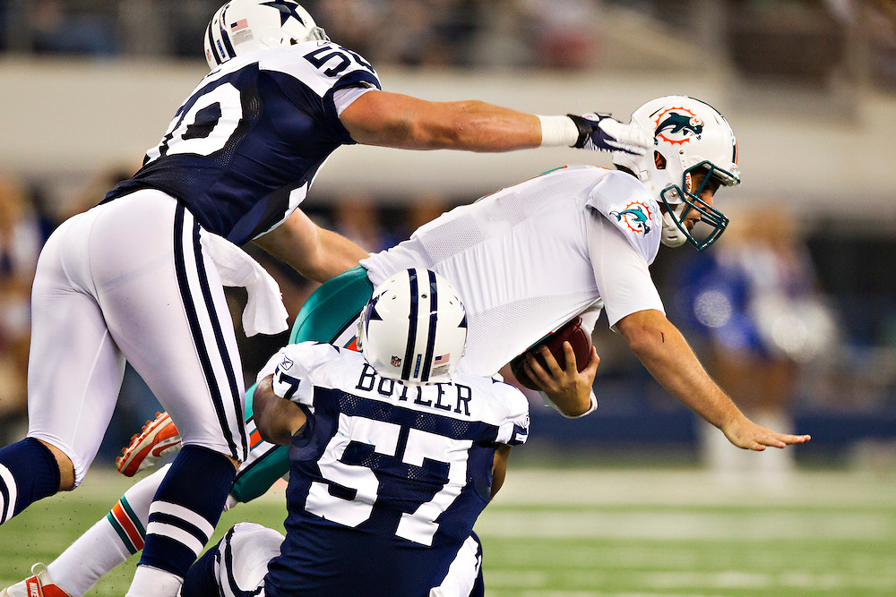 ARLINGTON, TX - NOVEMBER 24:   Matt Moore #8 of the Miami Dolphins is tackled by Victor Butler #57 of the Dallas Cowboys at Cowboys Stadium on November 24, 2011 in Arlington, Texas.  The Cowboys defeated the Dolphins  20 to 19.  (Photo by Wesley Hitt/Getty Images) *** Local Caption *** Matt Moore; Victor Butler