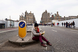 A woman catches up with her reading as Extinction Rebellion on climate change took place on North Bridge, Edinburgh pic copyright: Terry Murden @edinburghelitemedia