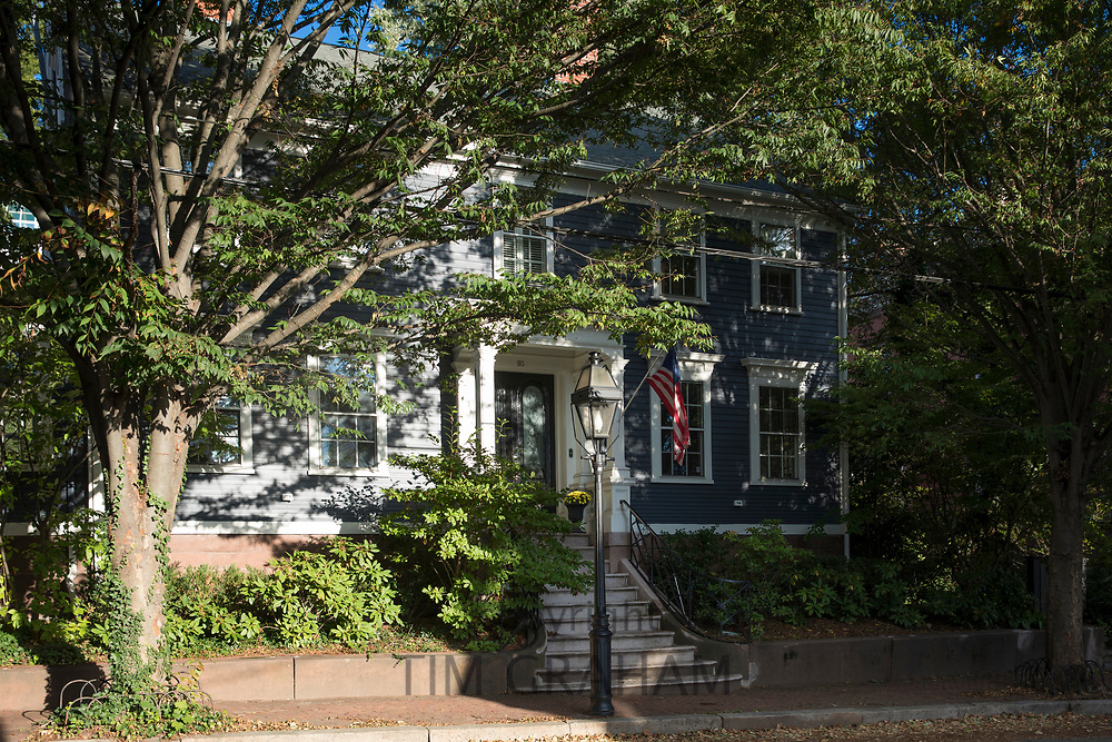 Wooden clapboard elegant period house with patriotic Stars and Stripes flag on Benefit Street in Providence, Rhode Island, USA