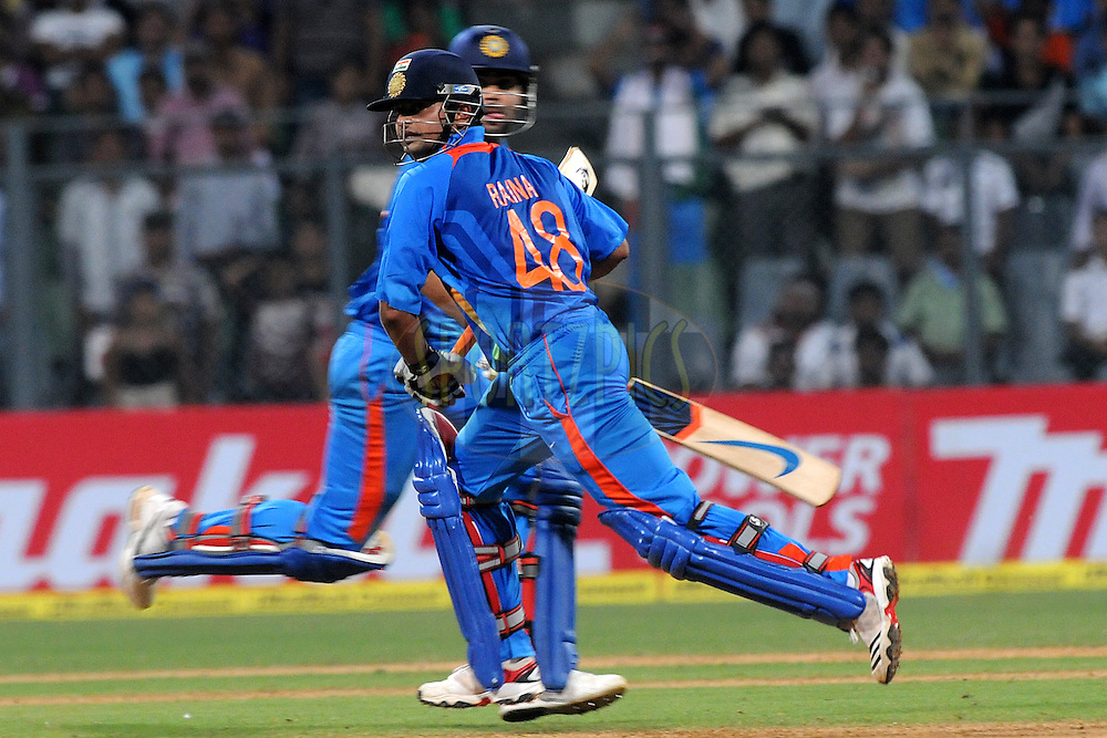 Suresh Raina of India and  Virat Kohli of India bat during the 4th One Day International ( ODI ) match between India and England held at the Wankhede Stadium, Mumbai on the 23rd October 2011..Photo by Pal Pillai/BCCI/SPORTZPICS