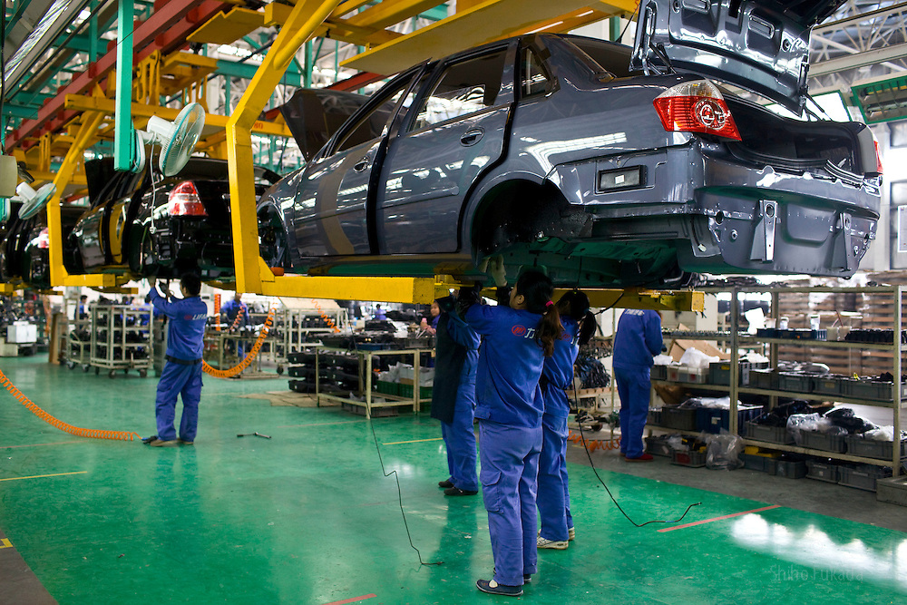 Workers assemble cars at Lifan Industry in Chongqing, China, March 4, 2009.