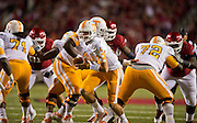 Nov 12, 2011; Fayetteville, AR, USA;  Tennessee Volunteers quarterback Justin Worley (14) looks to hand off the ball as offensive linemen Dallas Thomas (71) and Zach Fulton (72) block during a game against the Arkansas Razorbacks at Donald W. Reynolds Razorback Stadium. Arkansas defeated Tennessee 49-7. Mandatory Credit: Beth Hall-US PRESSWIRE