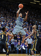MANHATTAN, KS - FEBRUARY 26:  Guard Rodney McGruder #22 of the Kansas State Wildcats scores between defenders Kim English #24 and Phil Pressey #1 of the Missouri Tigers during the second half on February 26, 2011 at Bramlage Coliseum in Manhattan, Kansas.  Kansas State defeated Missouri 80-70.  (Photo by Peter G. Aiken/Kansas State/Getty Images) *** Local Caption *** Rodeny McGruder;Kim English;Phil Pressey