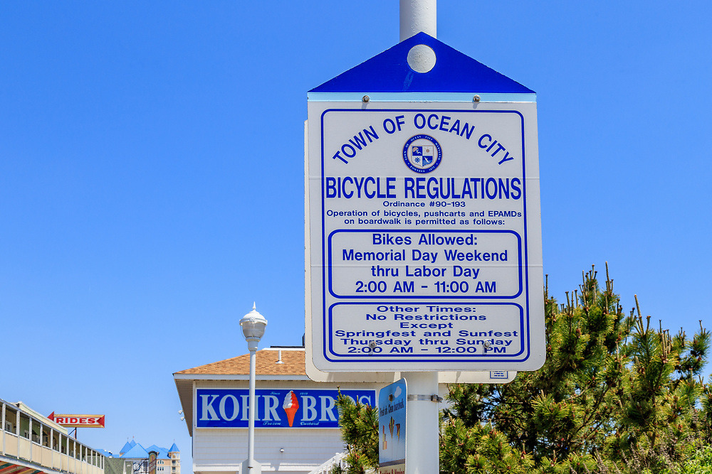 Ocean City, MD, USA - May 26, 2018: A sign with the town ordinance and regulations of bicycle use on the Ocean City boardwalk.