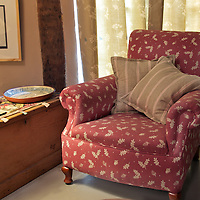 armchair and fabric furnishings in traditional house interior