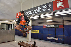"""© Licensed to London News Pictures. 07/01/2018. CHICAGO, USA.  A man takes part in the annual """"No Pants Subway Ride"""", a fun event taking place both in Chicago and worldwide, where people ride the subway wearing no trousers.  With Chicago experiencing an extreme cold snap currently, temperatures made taking part more challenging.  Photo credit: Stephen Chung/LNP"""