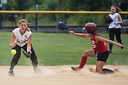 West Deptford's Brianna Fisher waits  for the ball as Gibbstown's Sydney Coleman steals second during a game at the Clayton Little League Complex Thursday July 7, 2011.