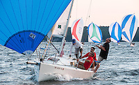 Jesse Thompson standing, Ryan Dempsey at the helm and the crew on the Gallant Fox sail across the finish line during Thursday evenings J80 race series with the Winnipesaukee Yacht Club.  (Karen Bobotas/for the Laconia Daily Sun)