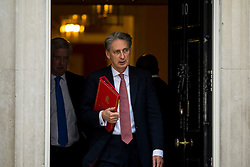 © Licensed to London News Pictures. 23/02/2016. London, UK. Defence Secretary MICHAEL FALLON (left) and Foreign secretary PHILIP HAMMOND (right) leave number 10 Downing Street in Westminster, London after cabinet meeting. Photo credit: Ben Cawthra/LNP