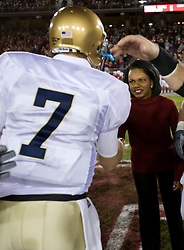 November 28, 2009; Stanford, CA, USA;  Notre Dame Fighting Irish quarterback Jimmy Clausen (7) meets Condoleezza Rice at midfield for the coin toss against the Stanford Cardinal at Stanford Stadium.  Stanford defeated Notre Dame 45-38.