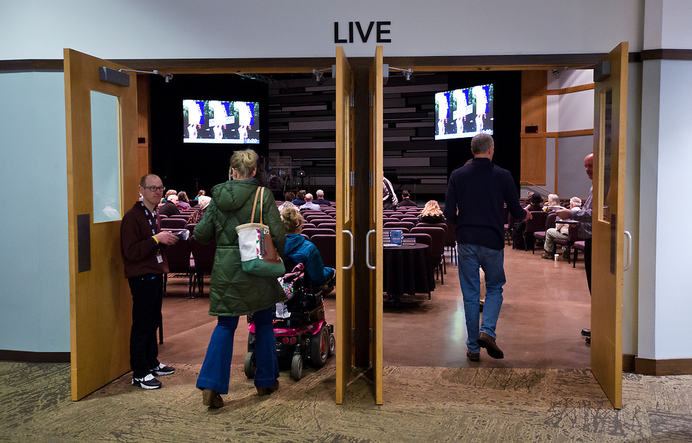 Congregants enter the Live Auditorium before Sunday service at Door Creek Church in Cottage Grove, Wisconsin, Sunday, Feb. 4, 2018.