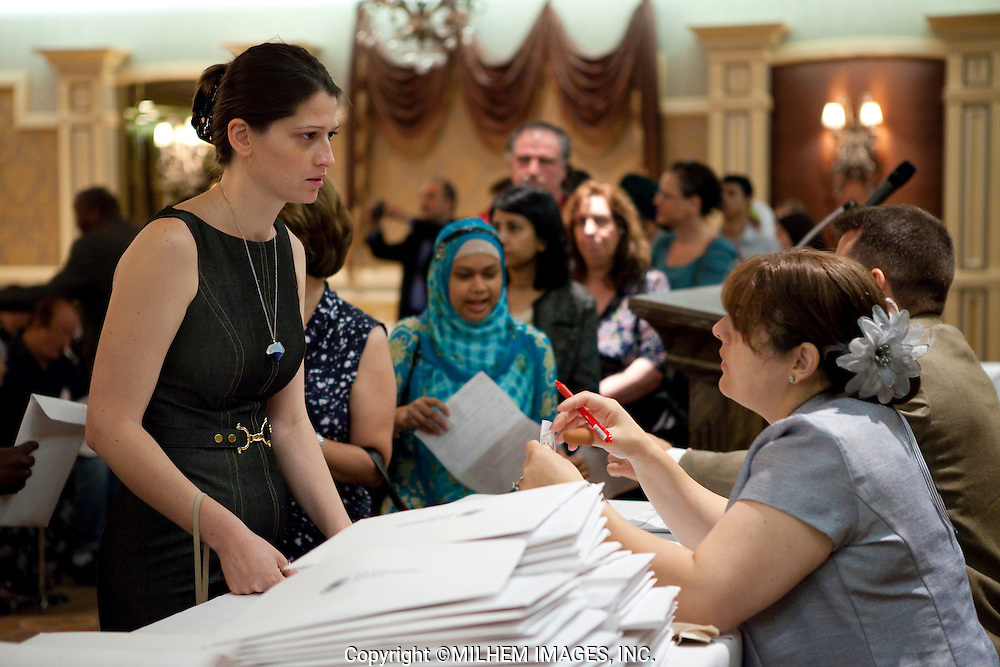 A crowd of more than two hundred immigrants gathered at the Swearing-In Ceremony held at Byblos Banquet Hall in Dearborn, Michigan on Friday, July 15, 2011.