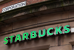 © Licensed to London News Pictures . 08/12/2012 . Manchester , UK . GV general view of sign above a Starbucks coffee shop on Corporation Street in Manchester City Centre  today (8th December 2012) . UKUncut are protesting outside Starbucks branches across the UK against the businesses corporation tax avoidance . Photo credit : Joel Goodman/LNP