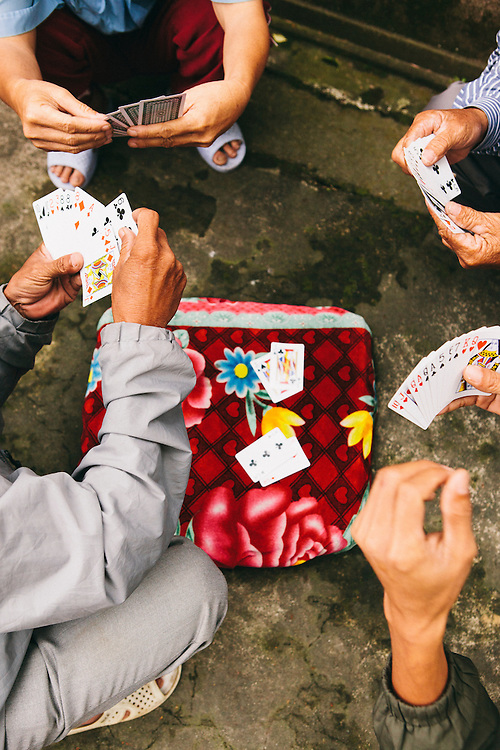 Cyclo drives playing cards in Hue, Vietnam