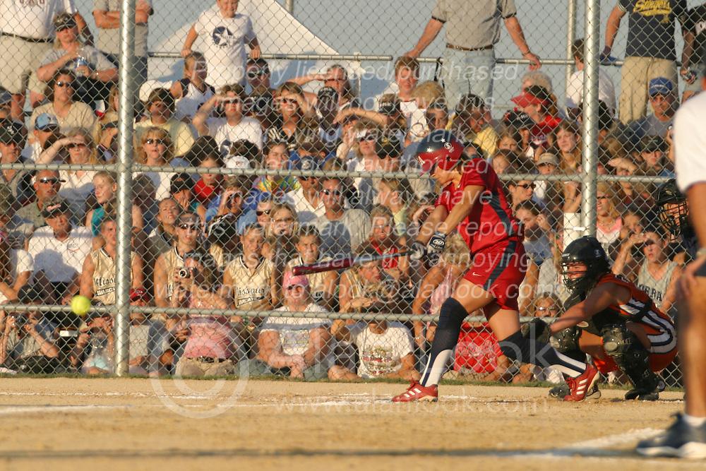 30 June 2004  USA's Amanda Freed puts the ball in play. Bloomington Lady Hearts vs. USA Olympic Softball Team.  Champion Field #1.  Normal Illinois