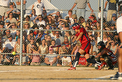 30 June 2004  USA's Amanda Freed puts the ball in play. Bloomington Lady Hearts vs. USA Olympic Softball Team.  Champion Field #1.  Normal Illinois