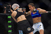 DALLAS, TX - MARCH 14:  Germaine de Randamie throws a punch at Larissa Pacheco during UFC 185 at the American Airlines Center on March 14, 2015 in Dallas, Texas. (Photo by Cooper Neill/Zuffa LLC/Zuffa LLC via Getty Images) *** Local Caption *** Germaine de Randamie; Larissa Pacheco