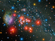 Artist's impression of massive star cluster within our Milky Way Galaxy ablaze with  glow of 14 rare red supergiant stars interspersed with young blue stars. The cluster contains perhaps 20,000 stars. Credit NASA. Science Astronomy