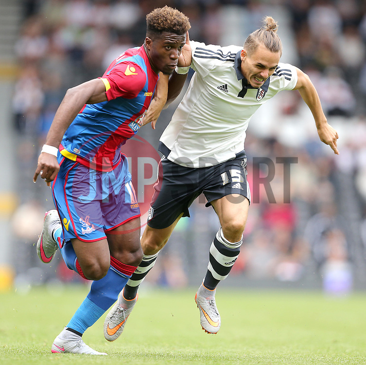 Wilfried Zaha of Crystal Palace and Kay Voser of Fulham - Mandatory by-line: Paul Terry/JMP - 07966386802 - 01/08/2015 - SPORT - FOOTBALL - Fulham,England - Craven Cottage - Fulham v Crystal Palace - Pre-Season Friendly
