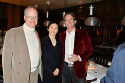 Left to right, HANS ULRICH OBRIST, KOO JEONG A and TIM JEFFERIES at a dinner to celebrate the publication of Obsessive Creative by Collette Dinnigan hosted by Charlotte Stockdale and Marc Newson held at Mr Chow, Knightsbridge, London on 9th February 2015.