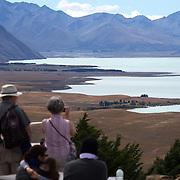 People on top of Mount John overlooking Lake Tekapo and the Mackenzie Country, South Island, New Zealand. 24th February 2011, Photo Tim Clayton