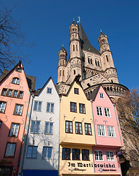 Gross St Martin Church and historic coloured houses in Fisch Markt or Fish Market in Cologne Germany