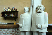 Dashanzi Bar featuring a statue of Mao Zedong and Karl Marx in Beijing's Dashanzi Art district. China's art scene is becoming popular among foreign art collectors pushing prices higher.