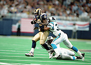 Two Carolina Panthers defensemen tackle Running Back Marshall Faulk (28) of the St. Louis Rams during a 48 to 14 win by Rams on 11/11/2001..©Wesley Hitt/NFL Photos