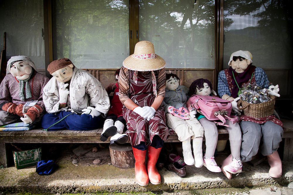 MIYOSHI, JAPAN - JULY 11 :  Tsukimi Ayano pose for a photo with her dolls in front of her house in Nagoro village, Miyoshi, Japan on July 11, 2015. Nagoro is a slowly shrinking village located in the valleys of Shikoku, Japan. According to Japan's Statistic Bureau, the percentage of people over 65 years old in Japan is 26.8% while that of the the world is 8.2%. The National Institute of Population and Social Security Research in Tokyo, Japan's population, now around 128 million, is expected to dip below 100 million in 2046.<br /> <br /> Photo: Richard Atrero de Guzman