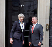 Theresa May <br /> Prime Minister <br /> welcomes His Majesty King Abdullah II of Jordan to Downing Street. 10 Downing Street, London, Great Britain <br /> 1st March 2017 <br /> <br /> Theresa May with <br /> King Abdullah II of Jordan <br /> <br /> <br /> Photograph by Elliott Franks <br /> Image licensed to Elliott Franks Photography Services