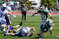 17 September 2011: Mike Heaton heads up field with the ball but his run is halted by Sam Jones during an NCAA Division 3 football game between the Aurora Spartans and the Illinois Wesleyan Titans on Wilder Field inside Tucci Stadium in.Bloomington Illinois.