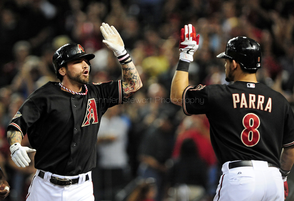 Oct. 5 2011; Phoenix, AZ, USA; Arizona Diamondbacks infielder Ryan Roberts (14) is congratulated by teammate Geraldo Parra (8) after hitting a grand slam during the first inning against the Milwaukee Brewers at game four of the 2011 NLDS at Chase Field. The Diamondbacks defeated the Brewers 10-6.  Mandatory Credit: Jennifer Stewart-US PRESSWIRE.