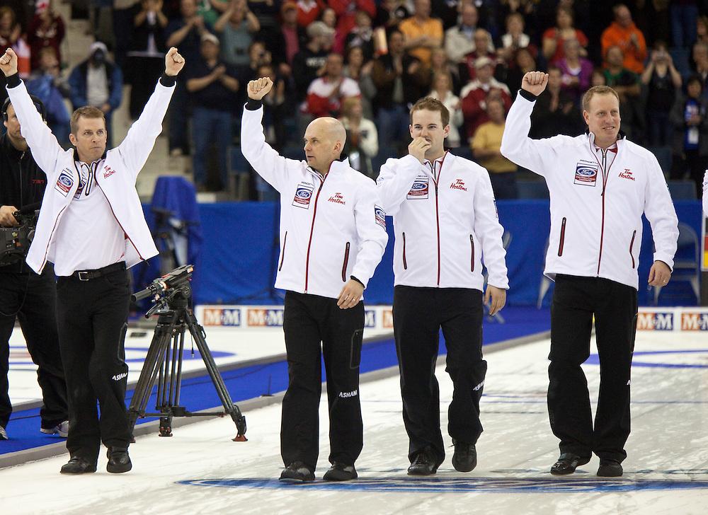 during the gold medal game at the Ford World Men's Curling Championships in Regina, Saskatchewan, April 10, 2011.<br /> AFP PHOTO/Geoff Robins