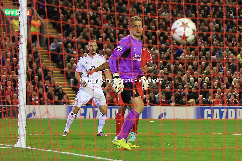 22nd October 2014 - UEFA Champions League - Group B - Liverpool v Real Madrid - Liverpool goalkeeper Simon Mignolet watches as a header from Karim Benzema of Real (L) loops over him and into the net for their 2nd goal - Photo: Simon Stacpoole / Offside.