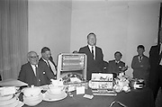 21/08/1966<br /> 08/21/1966<br /> 21 August 1966<br /> European Sea Angling Championship at Howth, Dublin. Picture shows Mr. Charles Haughey (right), Minister for Agriculture and Fisheries, at the prize table at the reception in the Lawrence hotel after the competition.