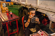 Members of the Sai Yong Hong traditional Chinese Opera troupe prepare for a performance in Chinatown, Bangkok.