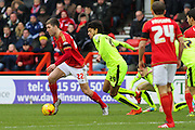 Huddersfield Town midfielder Philip Billing chases down Nottingham Forest midfielder Gary Gardner during the Sky Bet Championship match between Nottingham Forest and Huddersfield Town at the City Ground, Nottingham, England on 13 February 2016. Photo by Aaron  Lupton.
