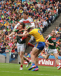 Mayo goalkeeper David Clarke rises highest to clear a high ball.<br />
