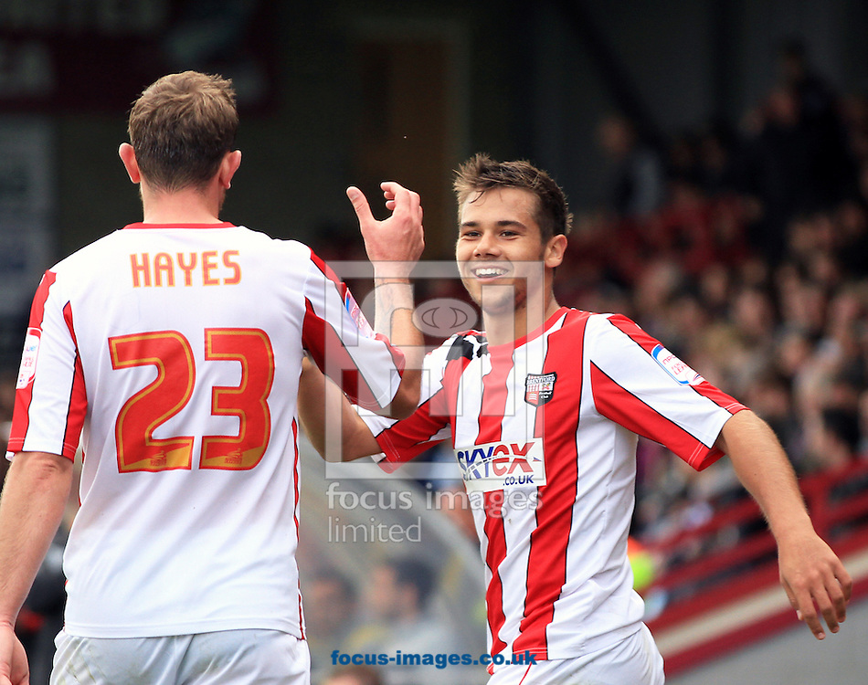 Picture by Richard Gould/Focus Images Ltd +447814 482222.13/10/2012.Harry Forrester ( R ) of Brentford celebrates his goal with Paul Hayes during the npower League 1 match at Glanford Park, Scunthorpe.