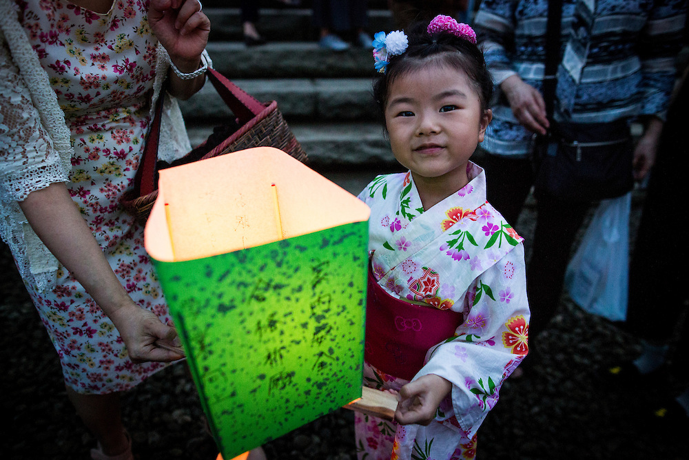 HIROSHIMA, JAPAN - AUGUST 6 : A woman wait to float candle lit lanterns with message on the Motoyasu River during the 71st anniversary activities, commemorating the atomic bombing of Hiroshima at the Hiroshima Peace Memorial Park on August 6, 2016 in Hiroshima, western Japan. Japan marks the 71st anniversary of the first atomic bomb that was dropped by the United States on Hiroshima on August 6, 1945 during World War II.  (Photo by Richard Atrero de Guzman/NURPhoto)