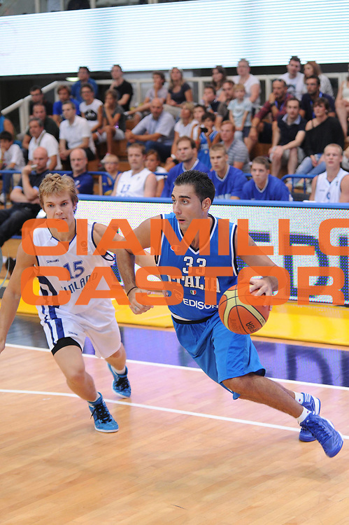 DESCRIZIONE : Trento Primo Trentino Basket Cup Finlandia Italia<br /> GIOCATORE : pietro aradori<br /> CATEGORIA : palleggio<br /> SQUADRA : Finlandia Nazionale Italia Maschile <br /> EVENTO :  Trento Primo Trentino Basket Cup<br /> GARA : Finlandia Italia<br /> DATA : 25/07/2012<br /> SPORT : Pallacanestro<br /> AUTORE : Agenzia Ciamillo-Castoria/C.De Massis<br /> Galleria : FIP Nazionali 2012<br /> Fotonotizia : Trento Primo Trentino Basket Cup Finlandia Finlandia<br /> Predefinita :