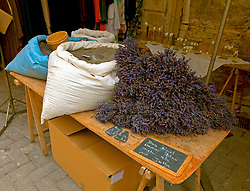 Mounds of lavender for sale at the Sunday flea market in LIsle-sur-la-Sorgue. Vintage clothing, toys, and antiques share sidewalk space with amazing food and working artists during this open-air market for which the town of L'Isle-sur-la-Sorgue is famous.