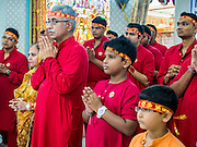 05 OCTOBER 2014 - GEORGE TOWN, PENANG, MALAYSIA:  People pray in the Krishna temple before a procession honoring Durga in George Town during the Navratri procession. Navratri is a festival dedicated to the worship of the Hindu deity Durga, the most popular incarnation of Devi and one of the main forms of the Goddess Shakti in the Hindu pantheon. The word Navaratri means 'nine nights' in Sanskrit, nava meaning nine and ratri meaning nights. During these nine nights and ten days, nine forms of Shakti/Devi are worshiped.   PHOTO BY JACK KURTZ