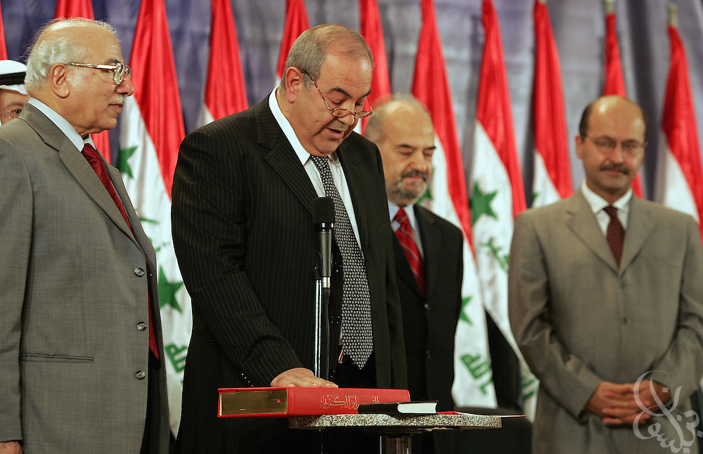 Iraqi Interim Prime Minister Iyad Allawi (2nd from left) is sworn in by Iraqi Supreme Court Judge Medhat al-Mahmood (l) during a June 28, 2004 ceremony in Baghdad, Iraq.