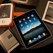 Grouping of different e-book readers, i-pad, Sony, Nook and BE Book.  E-book reader, also called an e-book device or e-reader, is an electronic device that is designed primarily for the purpose of reading digital books and periodicals
