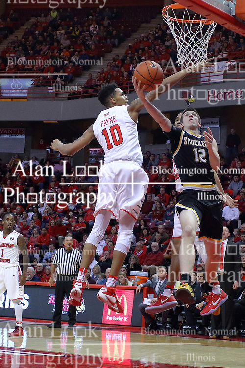 14 January 2017:  Austin Reaves with the scoop shot defended by Phil Fayne(10) and Tony Wills(12) during an NCAA  MVC (Missouri Valley conference) mens basketball game between the Wichita State Shockers the Illinois State Redbirds in  Redbird Arena, Normal IL