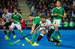 Germany's Florian Fuchs shoots while Kyle Good of Ireland looks to block. Ireland v Germany - Unibet EuroHockey Championships, Lee Valley Hockey & Tennis Centre, London, UK on 23 August 2015. Photo: Simon Parker