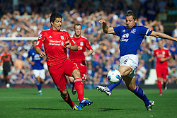 LIVERPOOL, ENGLAND - Saturday, October 1, 2011: Liverpool's Luis Alberto Suarez Diaz in action against Everton's Phil Jagielka during the Premiership match at Goodison Park. (Pic by David Rawcliffe/Propaganda)