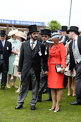 Sheikh Mohammed bin Rashid al Maktoum and his wife Princess Haya of Jordan at the Investec Derby 2013 held at Epsom Racecourse, Epsom, Surrey on 1st June 2013.